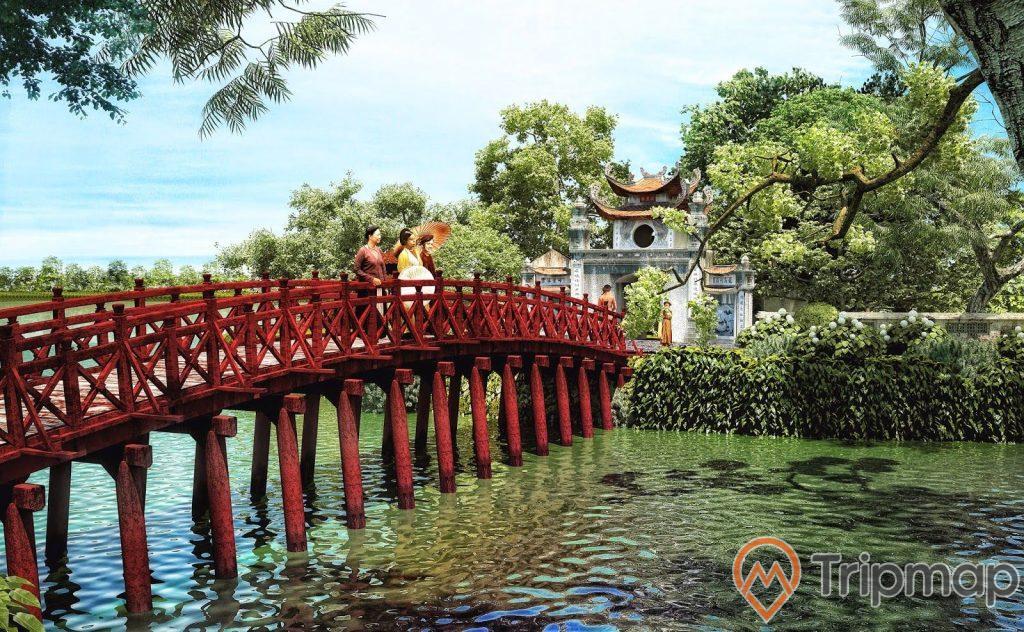cây cầu thê húc màu đỏ kết nối với đền ngọc sơn