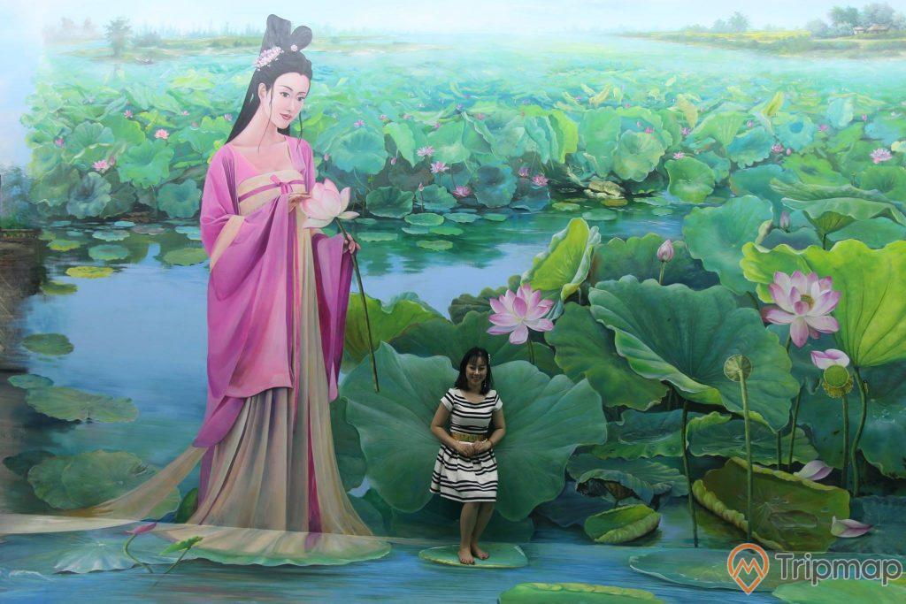 Bảo tàng tranh 3D, tranh nhiều hình bông sen, người phụ nữ mặc áo hồng cầm bông hoa sen, người phụ nữ mặc váy trắng đang ngồi trên lá sen